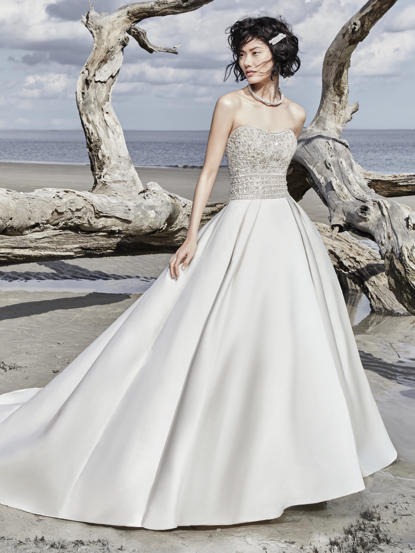 Phoenix by Sottero and Midgley. An elegant princess wedding dress with unique touches, this Carlo Satin ballgown features a bodice of beaded embroidery and Swarovski crystals. Complete with strapless scoop neckline. Finished with crystal buttons trailing from zipper to hemline. Princess Ballgowns For Royal Weddings