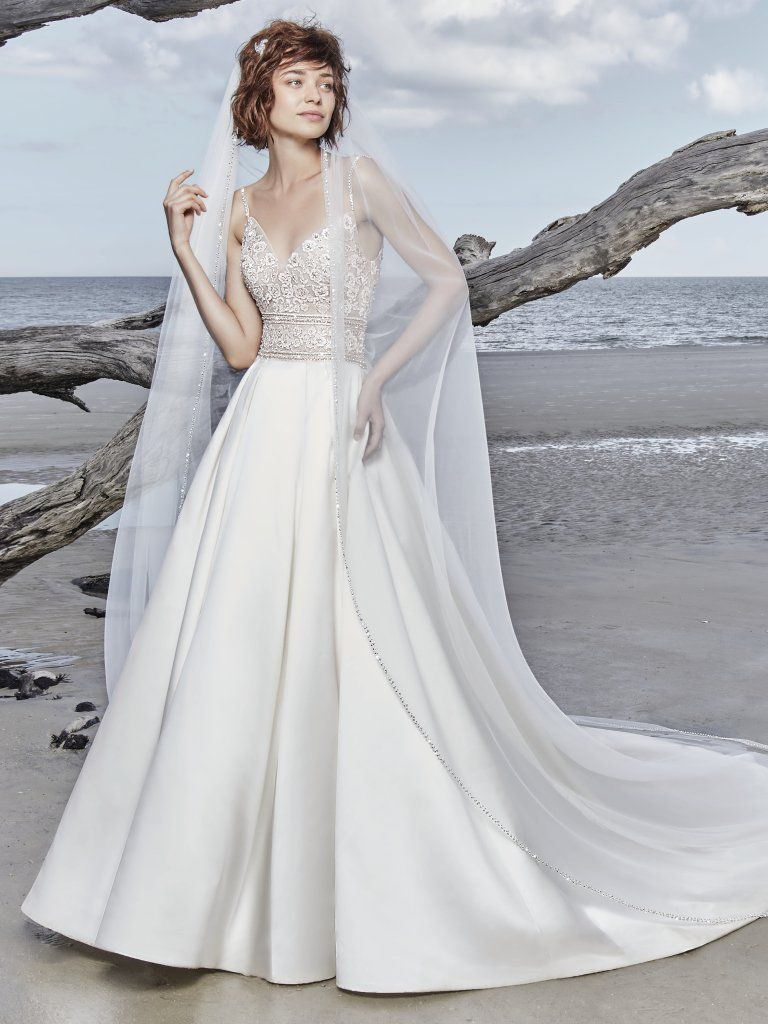 2019 Satin Wedding Dresses - Sottero and Midgley's Saylor satin wedding dress has an optional beaded veil to offer demure coverage.