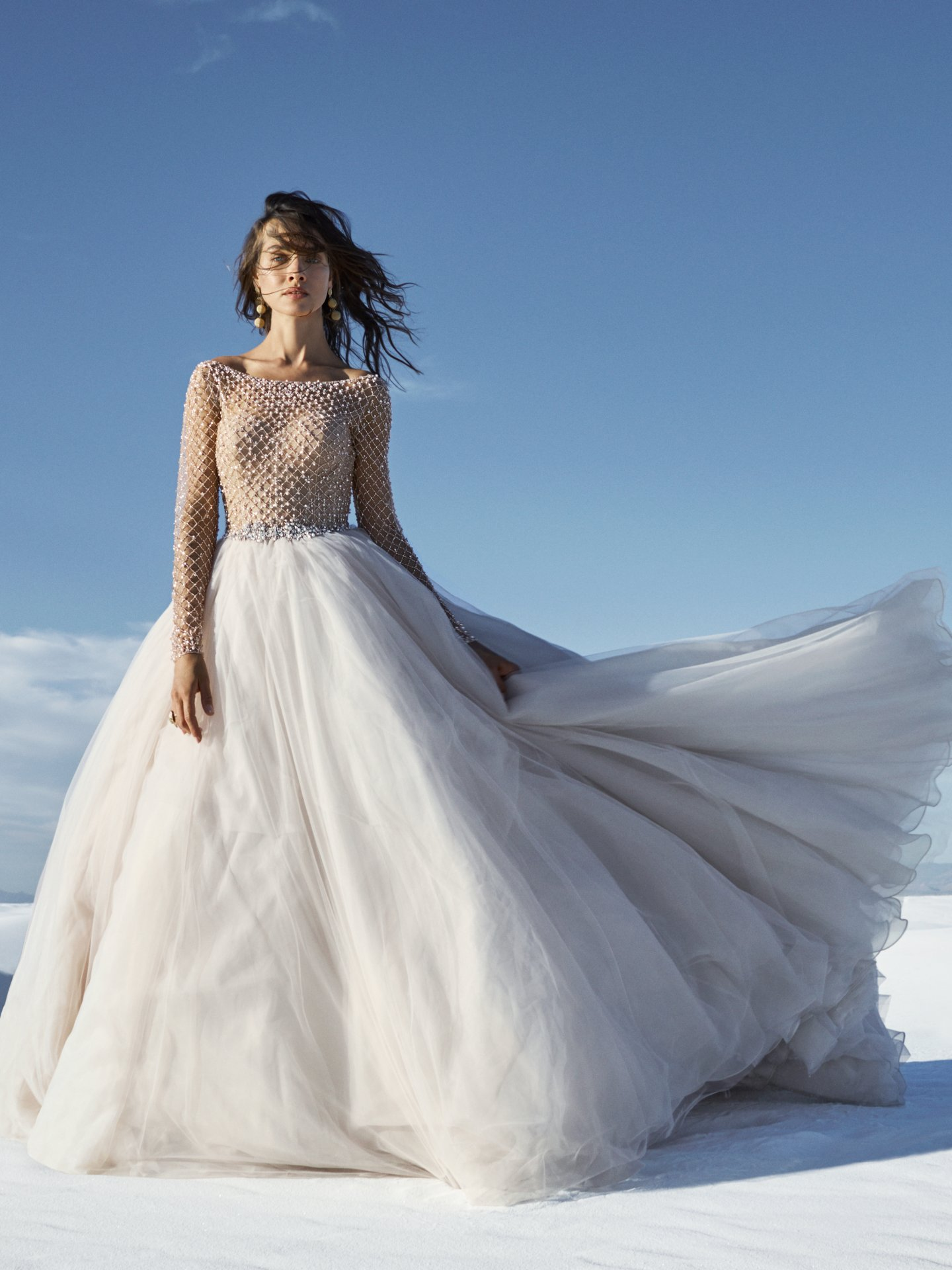 Regal and romantic, this sleeved princess wedding dress features a sheer bodice of geometric beading and Swarovski crystals, accenting the illusion bateau neckline, illusion long-sleeves. Fabulous Wedding Dresses With a Variety of Beaded Sleeves