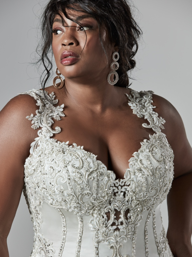 The Ultimate Guide to Wedding Gowns for Curvy Brides from Whitney of CurveGenius - Try the Darren Lynette wedding dress by Sottero and Midgley for a sexy option
