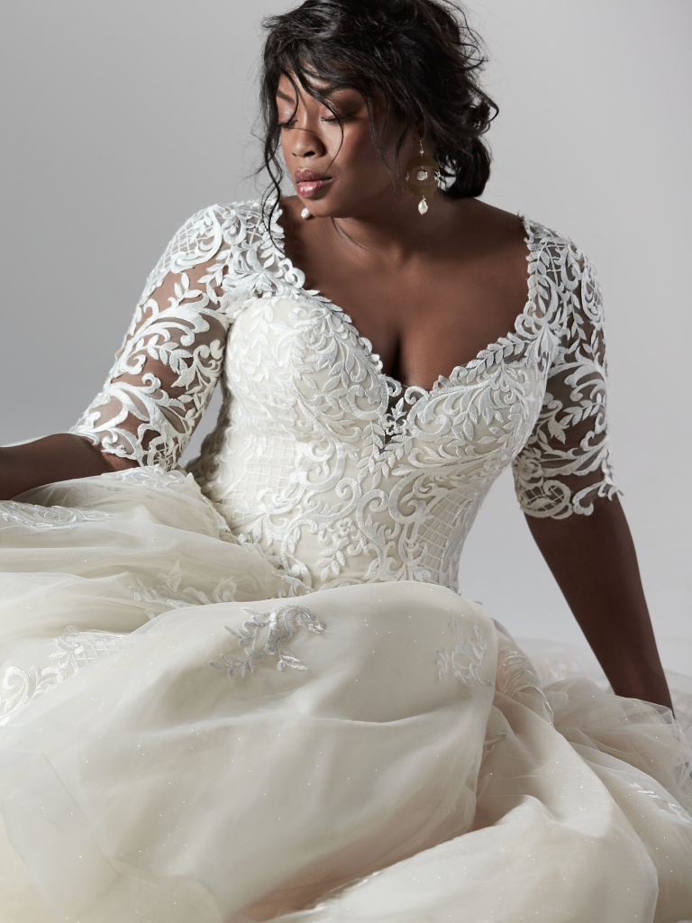 The Ultimate Guide to Wedding Gowns for Curvy Brides from Whitney of CurveGenius - Try the River Lynette Dawn for a royal option.